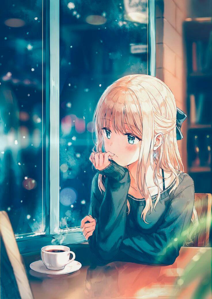 Ảnh 3: Cô gái suy tư bên ô cửa sổ cùng tách cà phê nghi ngút khói tạo nên một bầu không khí đầy tâm sự